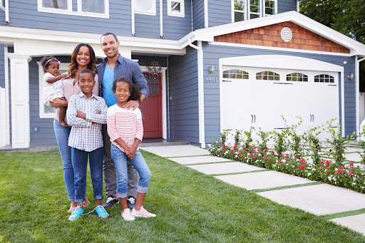 A family portrait outside their NW Indiana home happy about their new Garage Door Safety decisions